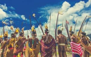 A group of native Indians holding traditional archery equipment