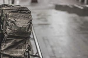 Tactical backpack on floor with molle attachments