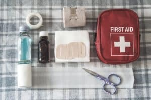 first aid kit on table with contents laid on show