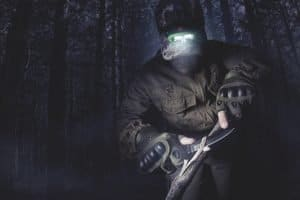 huter with a headlamp making a trap at night