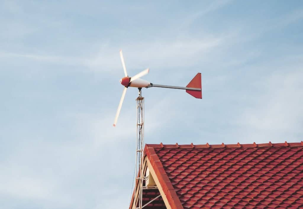 wind turbine on top of residential home roof