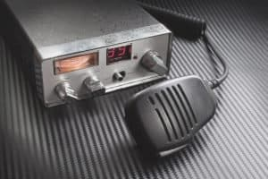 portable cb radio and receiver on table