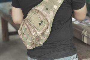one strap sling backpack on mans back