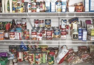 canned food stored on pantry shelving emergency store