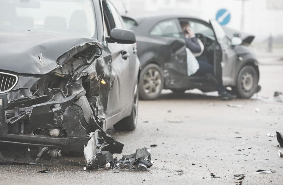 car crash on street with two cars