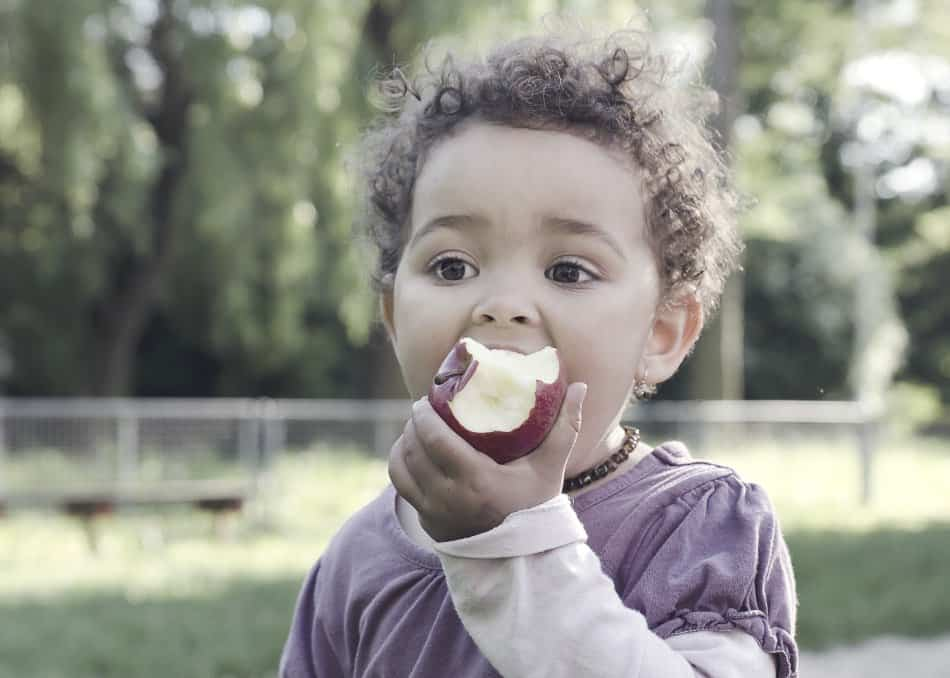 child eating apple as part of good nutrition in diet