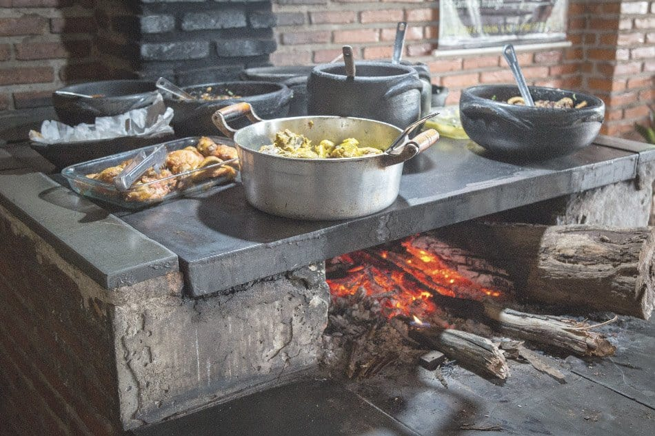 food cooking on a wood stove in the kitchen