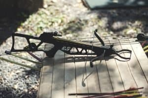 A crossbow pistol on a table outdoors