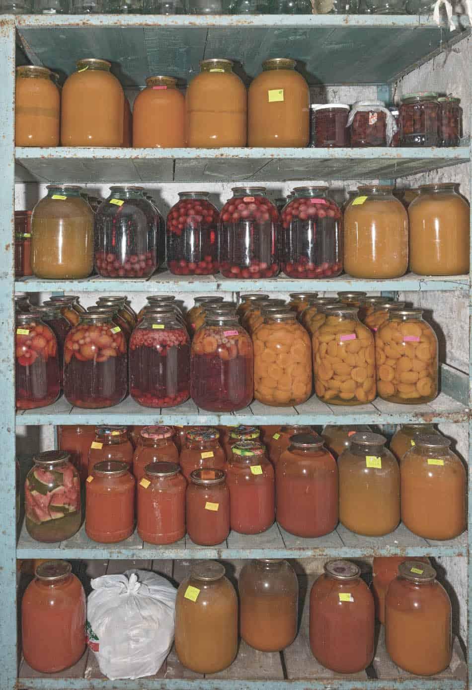 emergency food stores in mason jars on pantry shelving