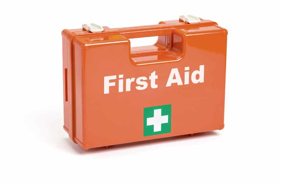 orange first aid case with white text and white cross on green background