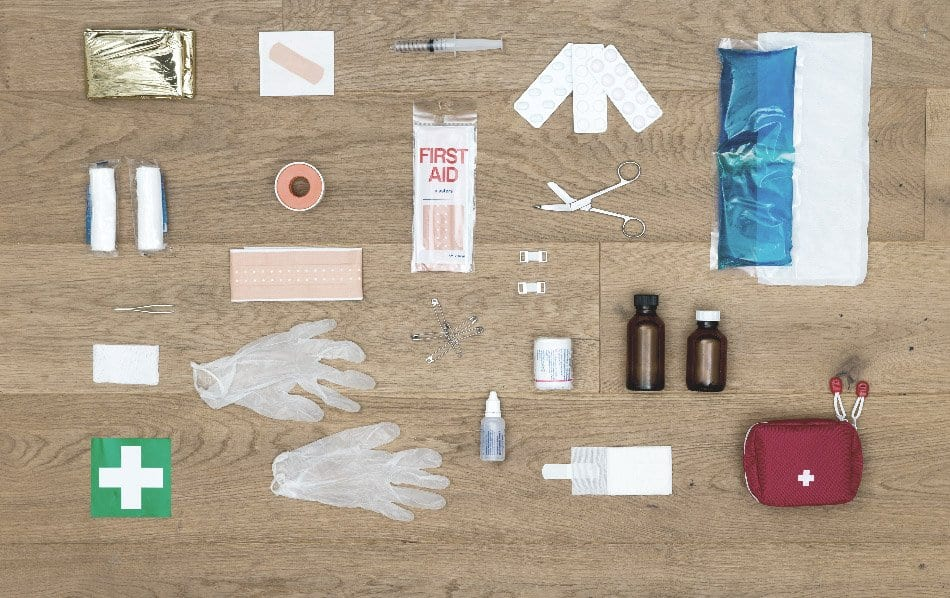 contents of first aid kit displayed on floor