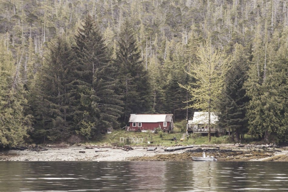 two homes side by side by lake in alaska off grid