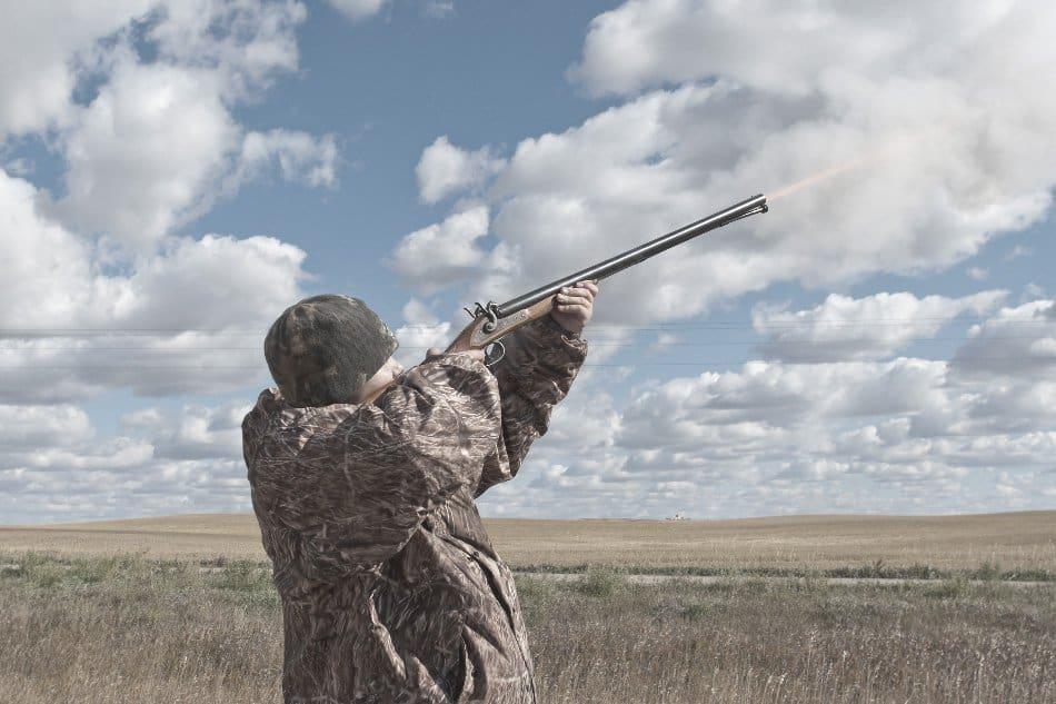 hunter shooting a muzzleloader gun into the air