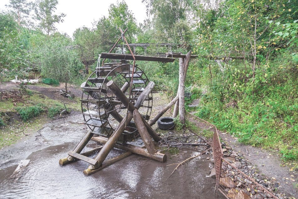 old retro water mill for generating electricity off grid