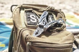 leatherman multi tool open and ready to use in a survival situation