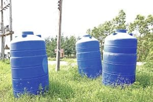 emergency water storage containers in field