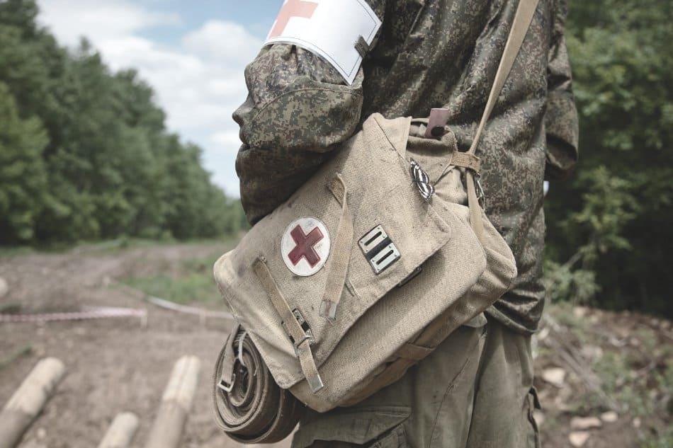 medical sling pack over shoulder of military medic person