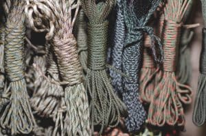 different colored paracord bundles set on table