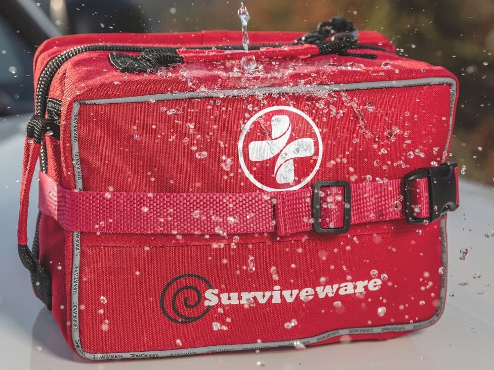 water being poured onto waterproof large first aid kit
