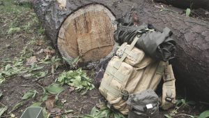 tactical backpack in the forest