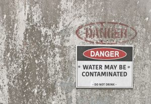 warning sign on wall telling you not to drink water as it may be contaminated