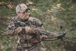 Hunting man in camo holding a wicked ridge invader g3 crossbow