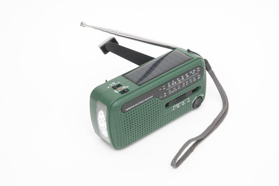 solar powered wind-up crank radio on table
