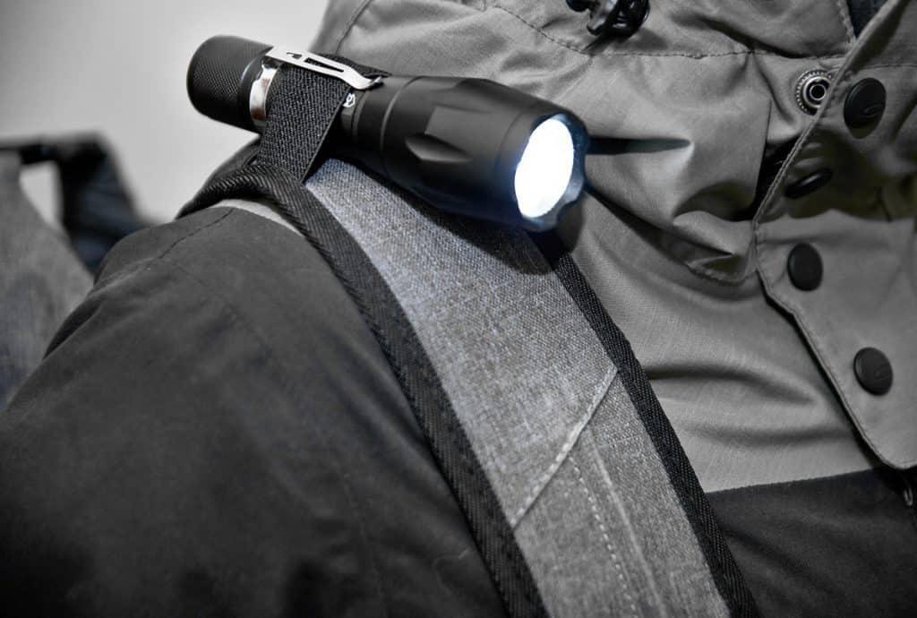 flashlight holder detail on seventy2 survival backpack strap