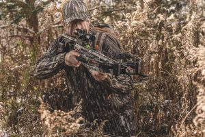 hunter in the trees taking aim with the fastest crossbow