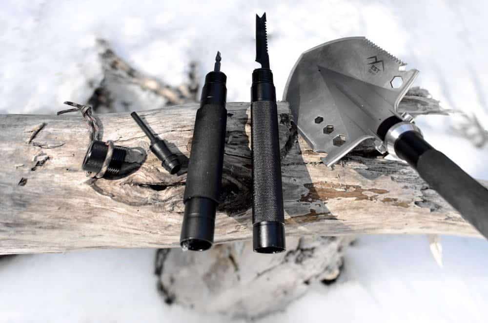 close up detail of tools in survival shovel handle