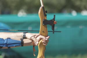 taking aim during an archery lesson for beginners