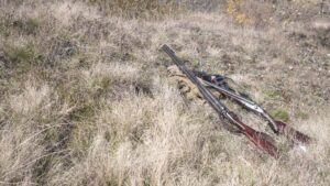 hunting rifles on ground with hunting gear